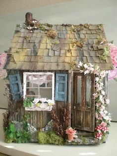 The Artist's Cottage Dollhouse - This is an ADORABLE little mini house, with lots of pics of the details and the inside. It's meant to be a miniature artist's cottage. Love the details! by Cinderella Moments - fairy gardens and minis