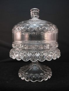 "EAPG Pedestaled Butter Dish with Draped Rim 8.5""H x 5.25""D, Wafered stem, lid has 3 seams, pattern of stars, hobnails, diamonds, zig zags, and wonderful draped rim, food holding area is (without the lid) 1.5"" deep x 5""diam. with a raised rim to hold the lid in place, domed lid is 5.25"" outerdiameter x 2.25""H. Between the floor of the base and the inside of the rim there is approximately 3.75""H for the butter."