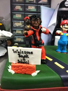 Probably the strangest cake I've ever made. Mario, Michael Jackson, and Tupac... Dont ask.