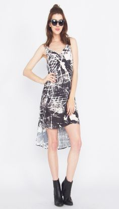 Paint Splatter Dress*Try this black and white abstract printed spaghetti strap dress with a high low hem for an easy way to dress up for summer! It looks great with black heels for a night out.