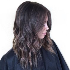 medium wavy brown hairstyle with subtle highlights