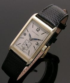 A 14ct gold rectangular vintage Longines watch, 1930s