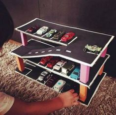 A toy garage is a simple structure to store and display collected toys. Cardboard Crafts Kids, Cardboard Car, Kids Toys For Boys, Diy For Kids, Crafts For Kids, Diy Toys For Toddlers, Festa Hot Wheels, Toy Garage, Toddler Activities