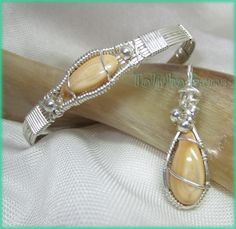 Elk tooth ivories wire wrapped into a sterling silver wire bracelet and pendant.