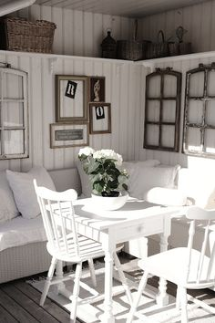 all things white/ i love the idea of benches with beautiful cushions to the corner, chairs on the two other sides of the table or better yet, maybe a round table windows as wall art...wonderful