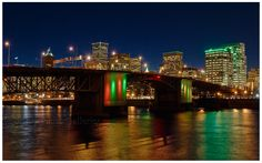 This captures two of my loves. I love the night, and I love Portland.  -  Morrison Bridge over the Willamette River at night. Portland, Oregon at Night; Landscape Photography by John Christopher