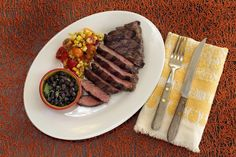 Grilled Skirt Steak, Beer-Braised Black Beans, and Blistered Corn and Tomato Salsa