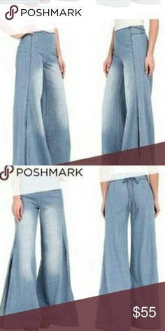 Free People wide legged side slit jean Light color denim. Never worn. Perfect condition. Too big on me! Side slits, back zipper, flare, sweet tie waist. Pet free smoke free home. Free People Jeans Flare & Wide Leg