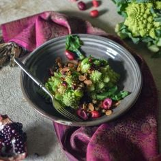 Romanesco cauliflower with harissa butter, pomegranate & riberries
