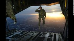 Soldier salutes as he jumps from C130. - Perfectly Timed Photography 2 Page 2 of 2 Best of Web Shrine