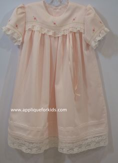 """Yoke dress with """"wave"""" overlay. Fabric is Swiss Satin Stripe Voille. Embroidery is by machine embroidery."""