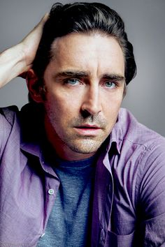 Gorgeous, sexy, green-eyed, smokey voiced Lee Pace in a purple shirt. He's a wonderful actor, too!