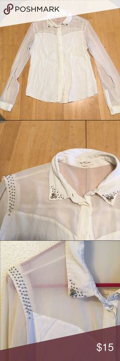 Urban Outfitters top Cream, button-down top with silver studs on collar and shoulders. Semi-sheer at the neckline. Rayon and polyester. Looks great with the layered with sweaters. Good condition, just has one little snag on right arm, as shown, but you can't see it when layered with other pieces. silence + noise Tops Button Down Shirts