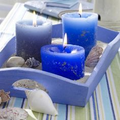 This Candle Centrepiece is easy to create, choose a tray, place candles in desired position, fill with sand & decorate with shells. Very simple yet effective. ♥