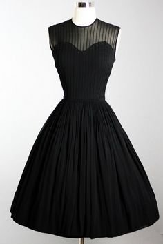 Cocktail Party Dress with slim silhouette, illusion fitted bodice, full skirt. ca 1950s