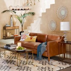Inspired by 1950s furniture silhouettes, the Hamilton Sofa feels as luxurious as it looks. It's covered in premium top-grain leather that's aniline dyed for a rich color variation that ranges from light to dark tan.
