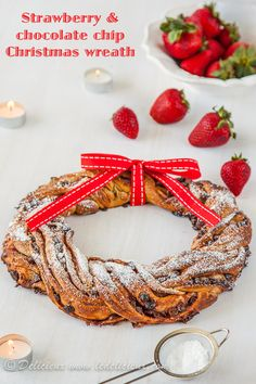 This gorgeous braided Strawberry & Chocolate Chip Christmas Wreath makes a wonderful edible Christmas table centrepiece. Want the recipe? Click to get it.
