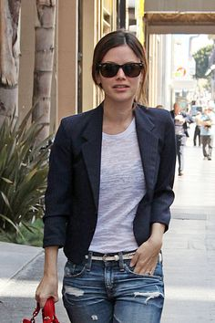 The master of casual chic- Rachel Bilson pairs a cropped tonal pinstrip, blazer with a burn-out white tee and distressed jeans. All fit to her shape showing off her figure.