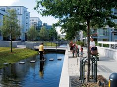Pedestrian street and effective stormwater management in the recently-revitalized Hammarby Sjöstad district,Stockholm. Click image for details via Atelier GroenBlauw & visit our popular Streets for Everyone board >> http://www.pinterest.com/slowottawa/streets-for-everyone/