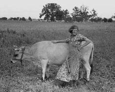 1938 Great Depression photo of Farmer's wife with cow, Southeast Missouri Farms.