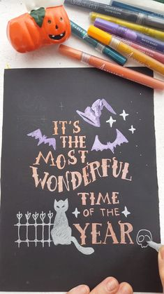 """Awesome Halloween lettering """"It's the most wonderful time of the year"""" made with Artistro metallic acrylic markers and paint pens. drawings acrylic paintings Halloween drawing with metallic markers Ceramics Projects, Art Projects, Fall Halloween, Halloween Crafts, Paint Pens For Rocks, Halloween Letters, Halloween Drawings, Metallic Paint, Metallic Rock"""