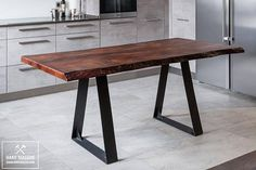 LOFT & Industrial dining table for 6 persons. A small dining table is made of solid wood with a live edge. Reclaimed wood is covered with natural oil-wax. The elegant legs of the table are made of metal and painted with powder paint in black. MODERN WOODEN TABLE TO ORDER. HIGHEST QUALITY