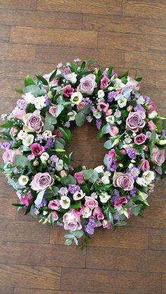 Funeral wreath of flowers lilac roses September flower lisianthus statice and more.. gorgeous! Made here at florist @ the swan