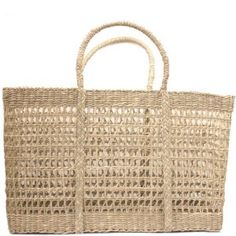 Beautiful open-weave handled bag that will take you from beach to markets. Hand-woven from sustainable Seagrass fibre, this flat bottomed bag is strong and sturdy. Throw in your everyday essentials for a eco-friendly and stylish day-bag solution. Use as a basket around the home. 45 x 18 x H28cm. Please note there will be a short delay shipping your order. We aim to ship by Fri, 16 March.