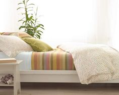 #NewYearNewBed (Montego Stripe Melon Blanket and Watercolor Dots Duvet)---perfect combination of stripes and dots