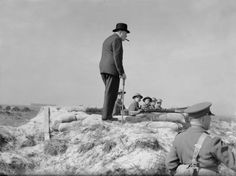 The Prime Minister Winston Churchill meets infantrymen manning a coast defence position near Hartlepool on 31 July 1940.