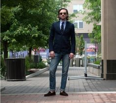 Shop this look on Lookastic:  http://lookastic.com/men/looks/navy-blazer-and-navy-tie-and-blue-dress-shirt-and-blue-jeans/238  — Navy Blazer  — Navy Tie  — Blue Dress Shirt  — Blue Jeans  — Brown Suede Loafers