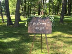Loved it! Pinned it! A Blooming Envy Design! Welcome sign with eucalyptus garland.