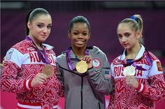 London Olympics 2012 - Gabrielle Douglas (middle) celebrates her individual gold medal.