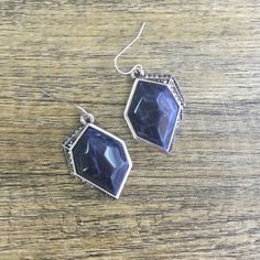Statement Earrings Follow your compass north to this everyday perfect pair of earrings. Set with a geometric shape and navy toned stone, outlined by pave crystals for understated elegance. Hypoallergenic, lead and nickel free. Ocean Jewelers Jewelry
