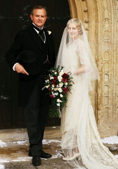 DOWNTON ABBEY Season 6 Episode 9: Robert Crawley, Earl of Grantham, with daughter Lady Edith Crawley at her wedding to Bertie Pelham.