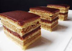 Opera Cake is a famous French cake made up of layers of coffee syrup-soaked almond sponge cake (jaconde), topped with coffee buttercream, and chocolate ganache, and coated with a chocolate glaze.