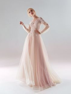 Style #1910L from the 2019 collection is a polka-dot lace A-line wedding dress with bishop sleeves and lace embroidery down the top, available in ivory-pink, ivory. From Papilio Boutique.
