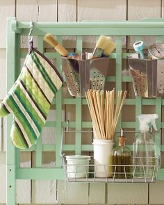 "BBQ Station: ""A lattice panel is more than just a pretty backdrop. When hung near your grill, it provides square upon square from which to hang brushes, pot holders, and more."""