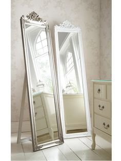 Lambeth Full Length Baroque Style Mirror - 180 x 44 cm This baroque style mirror has a full length shape that allows you to get a great view of yourself when checking out those outfits before leaving for work or a big night out!Sized at 180 x 44 cm, the framed mirror features baroque scroll detail to the top and is finished in a choice of off-white and silver.Useful info: Lambeth mirrorH 180, W 44 cmFull length baroque style mirrorBaroque scroll detailIdeal for dressing in front of2 colour…