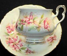 ROYAL ALBERT ENGLAND ART DECO CHAUCER SONNET  TEA CUP AND SAUCER