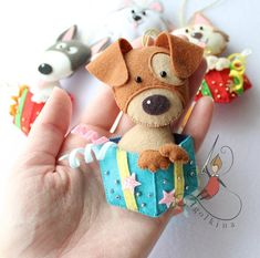 Cute puppies in a gift box will adorn any tree in the coming year. Dog sewn from felt. Boxes decorated with beads and shiny felt. Dog Ornaments, Felt Christmas Ornaments, Christmas Toys, Felt Crafts, Kids Crafts, Stick Crafts, Summer Crafts, Holiday Crafts, Easy Crafts