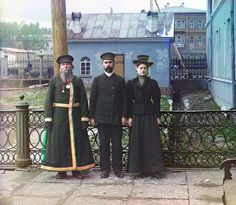 1910 A. P. Kalganov poses with his son and granddaughter for a portrait in the industrial town of Zlatoust in the Ural Mountain region of Russia. The son and granddaughter are employed at the Zlatoust Arms Plant—a major supplier of armaments to the Russian military since the early 1800s.