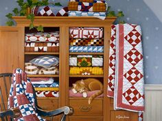 Shop Bits and Pieces jigsaw puzzle store for kids and adults! Surrounded by quilts in a cabinet, an orange cat sleeps peacefully 1000 piece jigsaw puzzle by John Sloane measures 20 x Country Art, Country Life, Country Homes, Country Living, Quilt Display, Colorful Quilts, Pics Art, Art Pictures, Cat Art