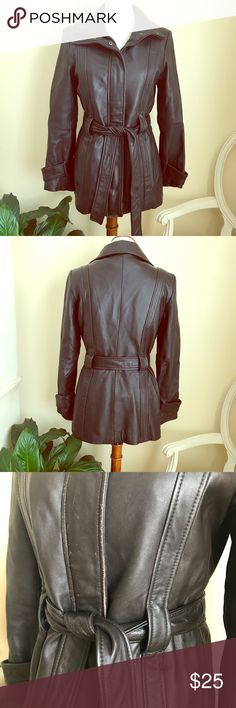 Woman's brown leather jacket Woman's brown leather zippered jacket with belt. Has a detachable liner with Thinsulate Insulation. Front of jacket has sign of wear and reflects the price. Pelle Studio Jackets & Coats