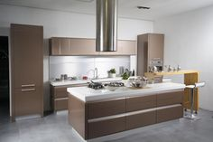 dazzling-modern-style-kitchen-cabinets-with-brown-kitchen-cabinet-accent-combined-white-marble-table-top-also-yellow-dining-table-incorporates-glides-featuring-comfy-bar-stool-and-floating-stainless-v-728x485.jpg (728×485)