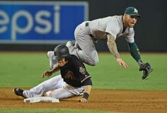Sacrifice for the double play -  Brett Lawrie of the Oakland Athletics turns a double play as AJ Pollock of the Arizona Diamondbacks slides into second base during the fifth inning at Chase Field on Aug. 29 in Phoenix.  - © Norm Hall/Getty Images