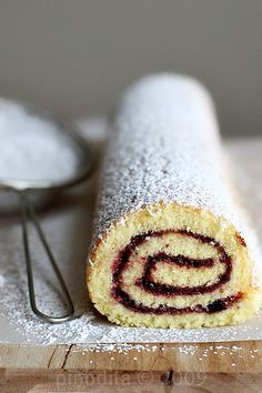 """""""ruby jelly"""" in Pat's lovely old fashioned jelly roll cake. Pat luckily made extra cake expecting it would be needed for the party, since her uncle horace swiped this lovely old fashioned one from the pantry"""