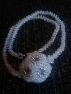 Doceria Sphere on Spinal Chain by DesignsByOnye on Etsy, $40.00