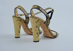 Gorgeous 1990s Anne Klein heels! Done in a snake skin. Made in Italy. Buckled ankle straps. 4.5 heel. Leather soles.  Excellent Vintage: Light expected wear to snake skin, some minimal wear to inner/outer soles.  SIZE: 7.5 TAG: 7.5M BRAND: Anne Klein  Measurements: Width across bottom: 3.25 Length of insole: 9.75 Heel: 4.5  * Any overpayment exceeding $4 USD on shipping will be refunded.  *All items are measured in US inches, Shoes are listed in the US size.  *All Items are carefully over…