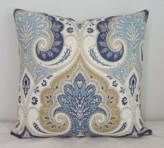 blue and beige paisley pillow